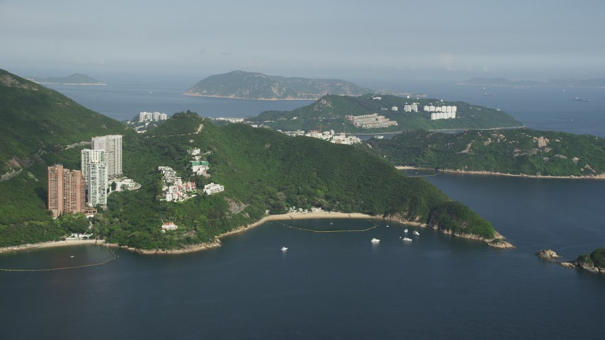 Approach Hong Kong Island Apartment Buildings and Pan to Reveal Waterfront Condos Aerial Stock Footage | SS01_0055
