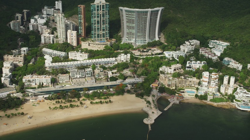 5K stock footage aerial video of pan across beachfront condos on Hong Kong Island, China Aerial Stock Footage | SS01_0056
