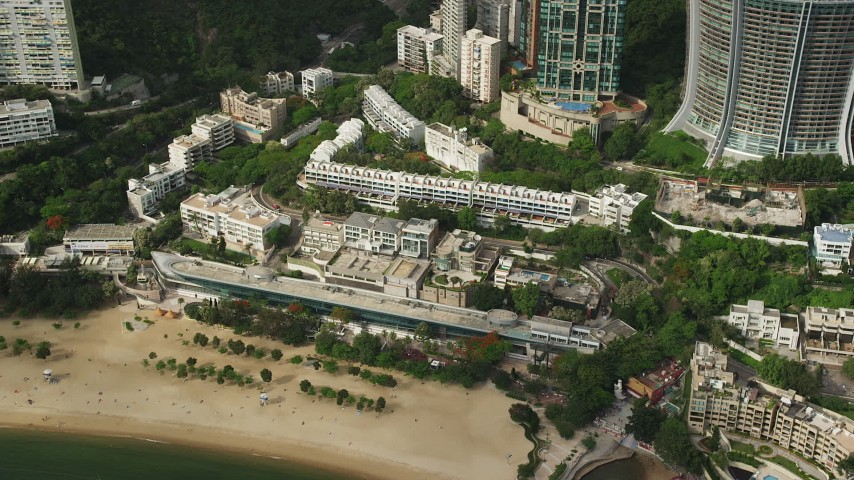 5K stock footage aerial video of beachfront condominium complex on Hong Kong Island, China Aerial Stock Footage | SS01_0057