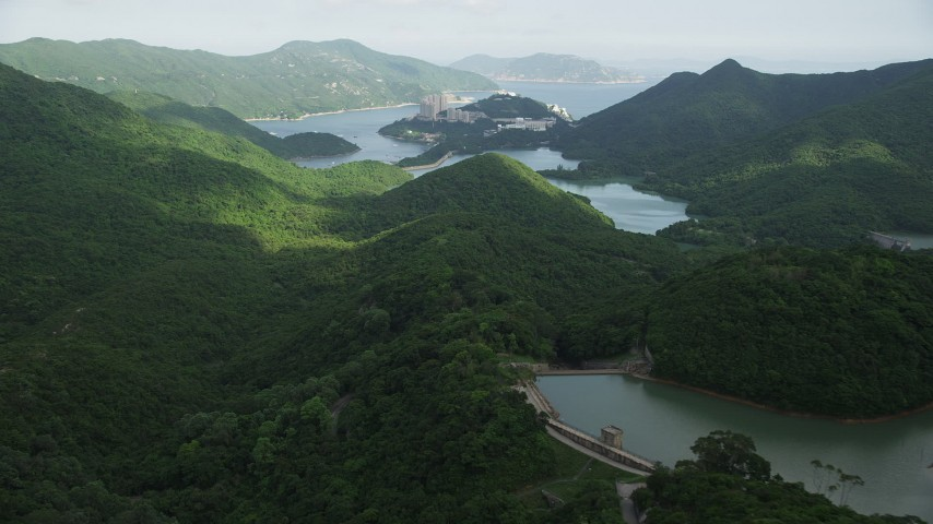 5K stock footage aerial video of green forest around reservoirs on Hong Kong Island, China Aerial Stock Footage | SS01_0061