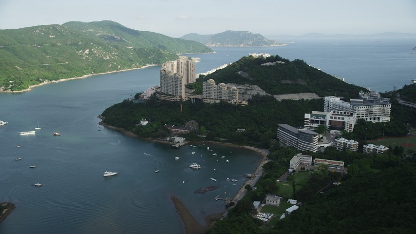 5K stock footage aerial video approach apartment complexes by Tai Tam Harbor on Hong Kong Island, China Aerial Stock Footage | SS01_0066