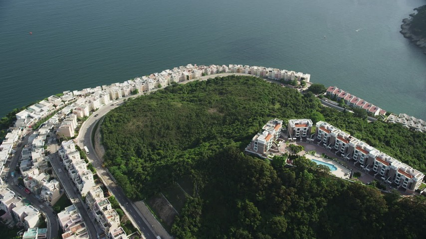 Orbit Rows of Waterfront Condominiums on Hong Kong Island in China Aerial Stock Footage | SS01_0069