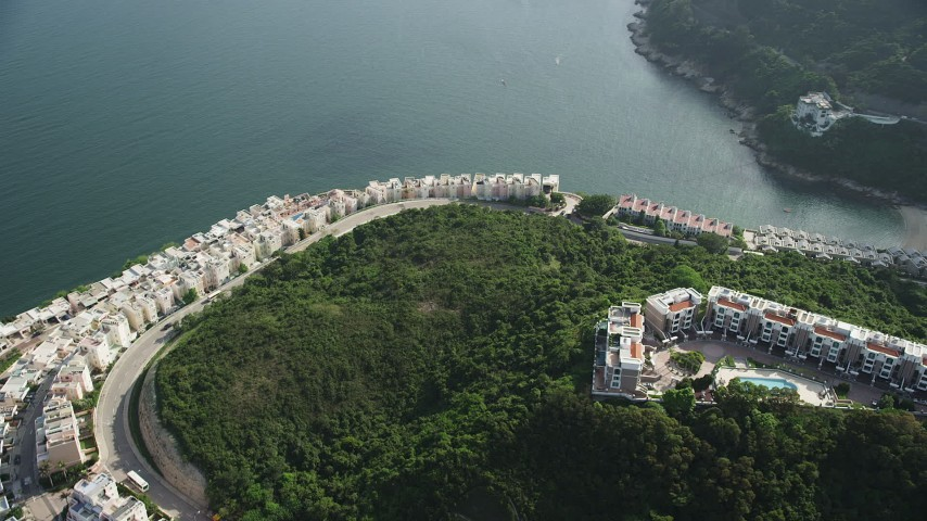 5K stock footage aerial video orbit rows of waterfront condominiums on Hong Kong Island in China Aerial Stock Footage | SS01_0069