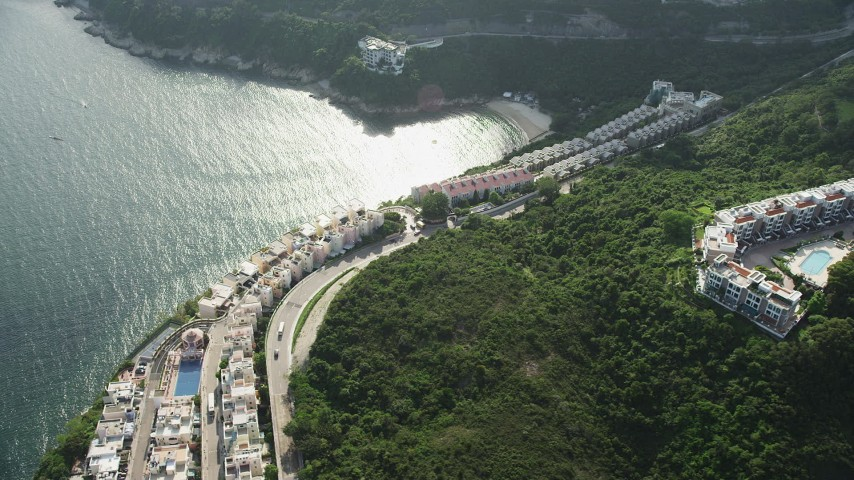 5K stock footage aerial video of waterfront condominium complexes on Hong Kong Island, China Aerial Stock Footage | SS01_0070