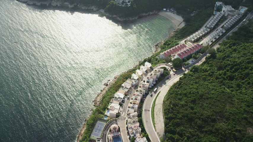 Fly Over Waterfront Condos and Turtle Cove on Hong Kong Island Aerial Stock Footage | SS01_0071