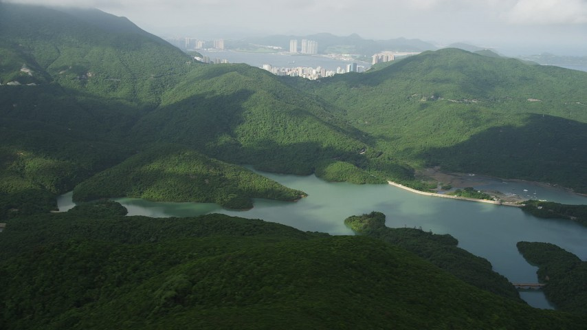 Tai Tam Reservoir and Green Hills on Hong Kong Island Aerial Stock Footage | SS01_0074