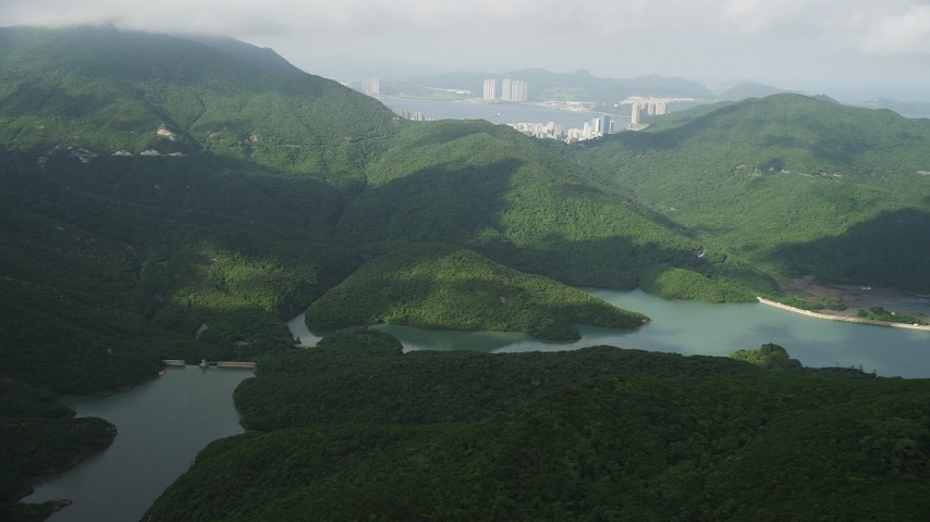 5K stock footage aerial video of Tai Tam Reservoir and green hills on Hong Kong Island, China Aerial Stock Footage | SS01_0074