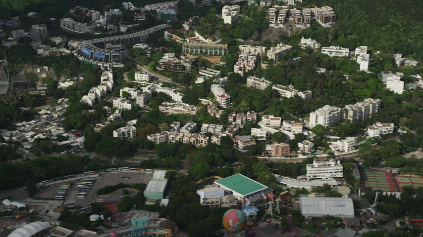 5K stock footage aerial video of hillside apartment buildings and Ocean Park on Hong Kong Island, China Aerial Stock Footage | SS01_0077