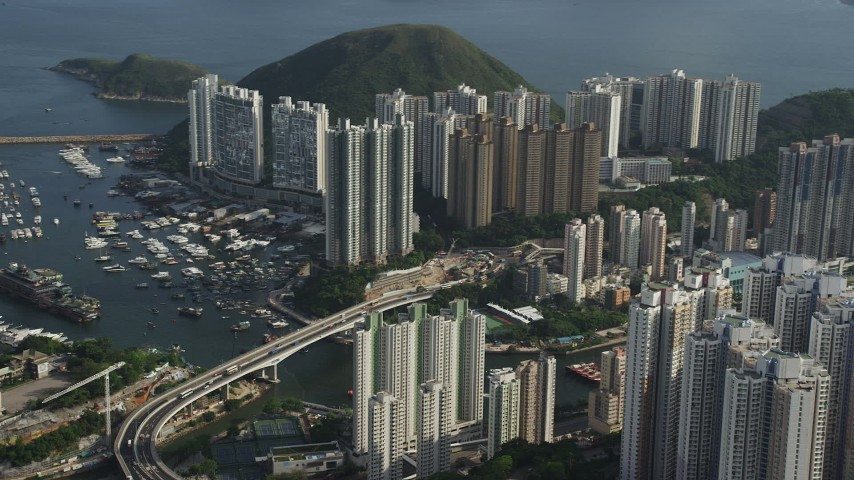 5K stock footage aerial video of waterfront apartment buildings and small bridge over Aberdeen Harbor on Hong Kong Island, China Aerial Stock Footage | SS01_0080