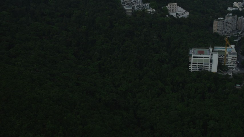 Fly Over Condo Complexes near the Summit of a Peak on Hong Kong Island Aerial Stock Footage | SS01_0081