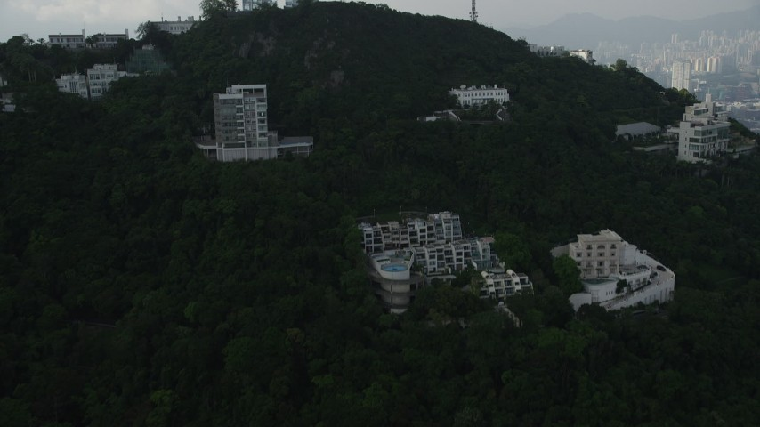 5K stock footage aerial video fly over condo complexes near the summit of a peak on Hong Kong Island, China Aerial Stock Footage | SS01_0081