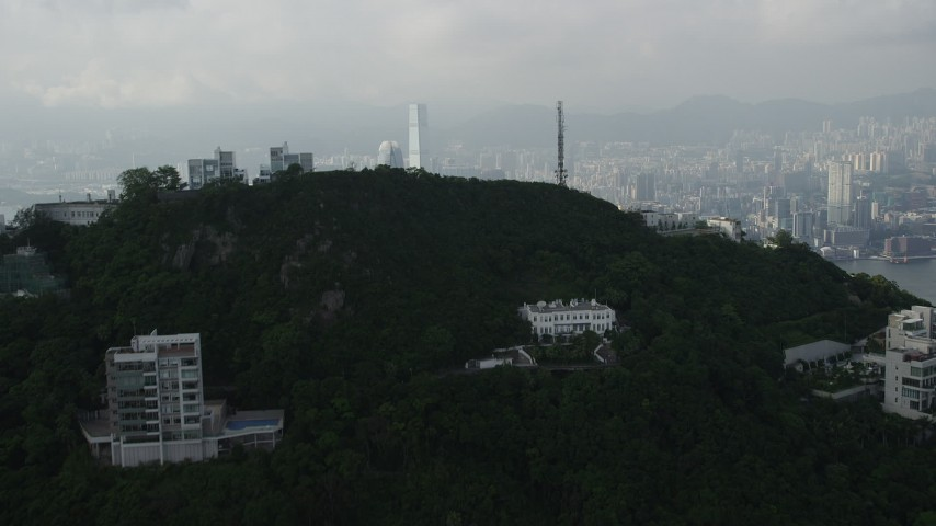 Fly Over Peak to Reveal Harbor and Skyscrapers on Hong Kong Island and Kowloon Aerial Stock Footage | SS01_0082