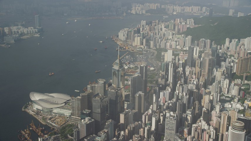 5K stock footage aerial video pan across harbor and convention center in Hong Kong, China Aerial Stock Footage | SS01_0084