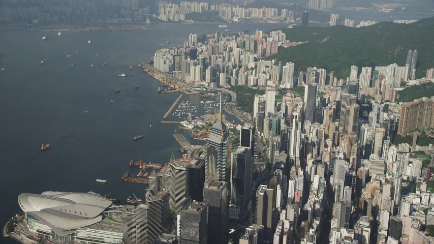 5K stock footage aerial video of skyscrapers on the shore of Victoria Harbor on Hong Kong Island, China Aerial Stock Footage SS01_0085 | Axiom Images