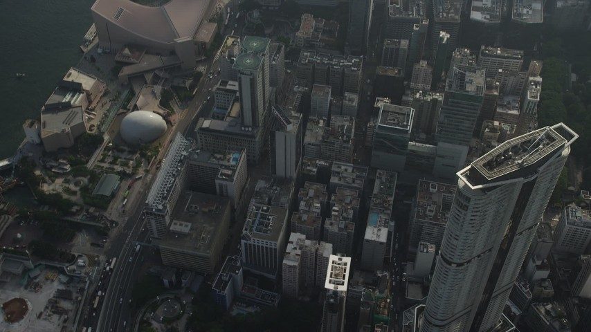 5K stock footage aerial video tilt from skyscraper to reveal waterfront concert hall and museum in Kowloon, Hong Kong Aerial Stock Footage | SS01_0091