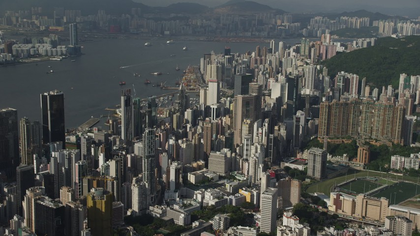 5K stock footage aerial video of skyscrapers on Hong Kong Island seen from the mountains, China Aerial Stock Footage SS01_0095 | Axiom Images