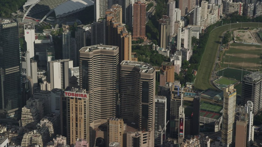 5K stock footage aerial video reverse view of Times Square Towers and reveal race track on Hong Kong Island, China Aerial Stock Footage | SS01_0100
