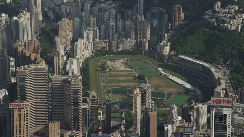 5K stock footage aerial video of race track on Hong Kong Island ringed by skyscrapers in China Aerial Stock Footage | SS01_0101