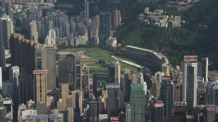 5K stock footage aerial video fly away from skyscrapers around a race track on Hong Kong Island, China Aerial Stock Footage | SS01_0102