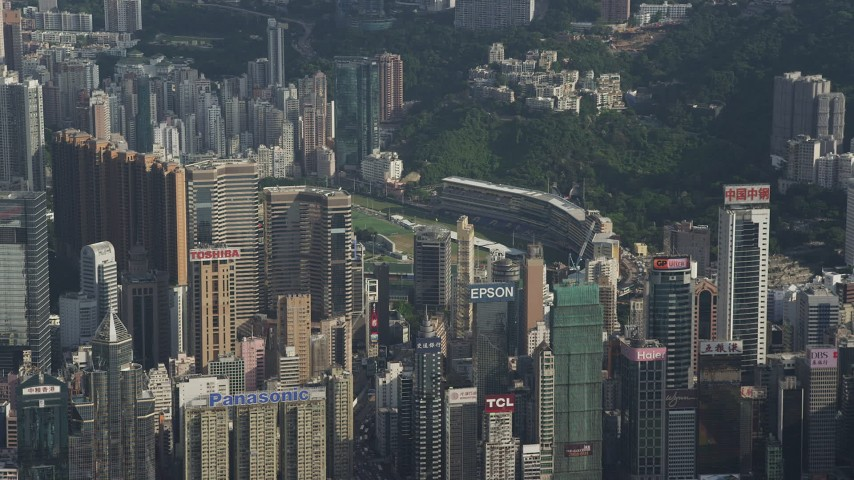 Fly Away from Skyscrapers with Brand Name Billboards on Rooftops on Hong Kong Island Aerial Stock Footage | SS01_0103