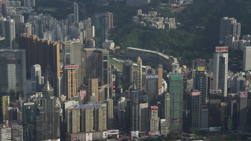 5K stock footage aerial video fly away from skyscrapers with brand name billboards on rooftops on Hong Kong Island, China Aerial Stock Footage | SS01_0103