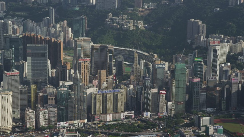 5K stock footage aerial video of rows of skyscrapers with billboards on Hong Kong Island, China Aerial Stock Footage | SS01_0104