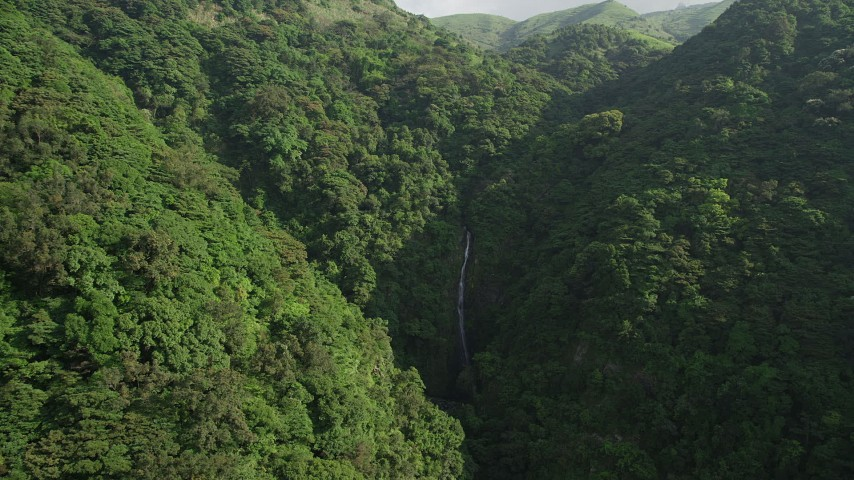 5K stock footage aerial video approach a waterfall in the mountains with forest on Hong Kong Island, China Aerial Stock Footage | SS01_0108