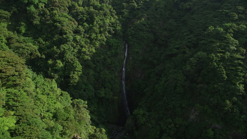 Reverse View of Waterfall and Forest in the Mountains of Hong Kong Island Aerial Stock Footage | SS01_0110