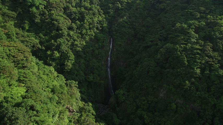 5K stock footage aerial video of reverse view of waterfall and forest in the mountains of Hong Kong Island, China Aerial Stock Footage | SS01_0110
