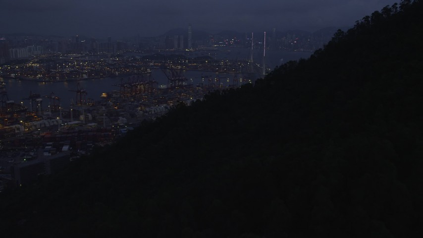 5K stock footage aerial video tilt to reveal the Port of Hong Kong and the Stonecutters Bridge at night, China Aerial Stock Footage | SS01_0111