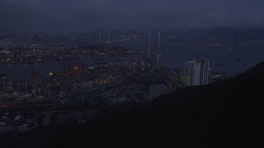 Approach the Port of Hong Kong and the Stonecutters Bridge at Night Aerial Stock Footage | SS01_0112