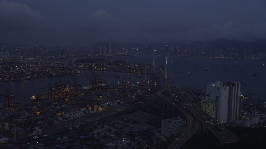 Fly Over the Port of Hong Kong to Approach Stonecutters Bridge at Night Aerial Stock Footage | SS01_0113