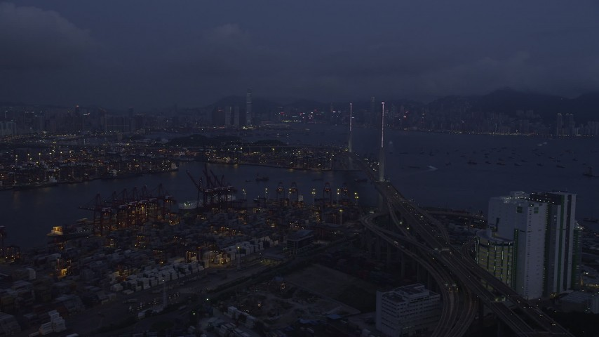 5K stock footage aerial video fly over the Port of Hong Kong to approach Stonecutters Bridge at night, China Aerial Stock Footage | SS01_0113