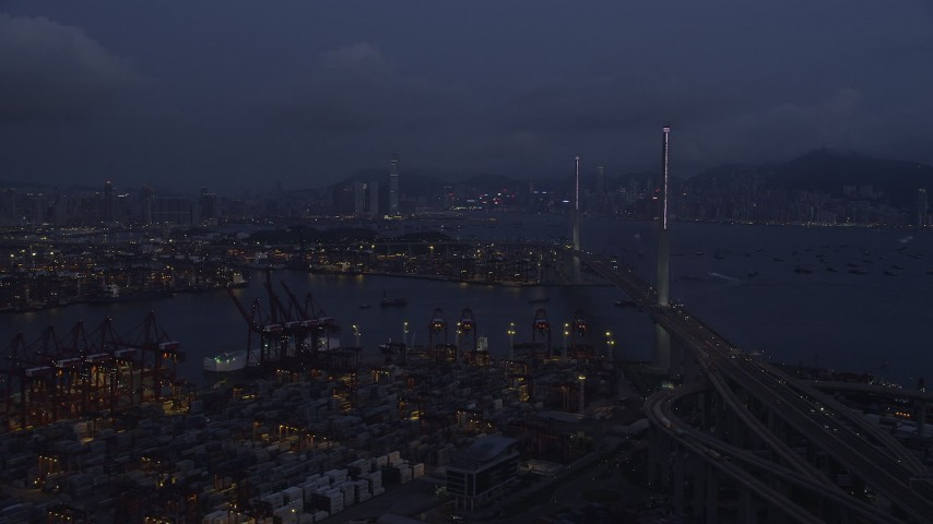 5K stock footage aerial video of flying over the Port of Hong Kong to approach the Stonecutters Bridge at night, China Aerial Stock Footage | SS01_0114
