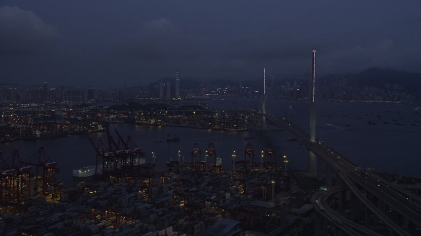 Fly Over Containers at the Port of Hong Kong toward Center of Stonecutters Bridge at Night Aerial Stock Footage | SS01_0115
