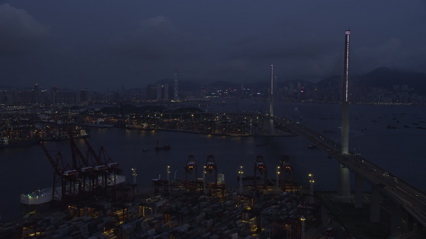 5K stock footage aerial video fly over containers at the Port of Hong Kong toward center of Stonecutters Bridge at night in China Aerial Stock Footage | SS01_0115