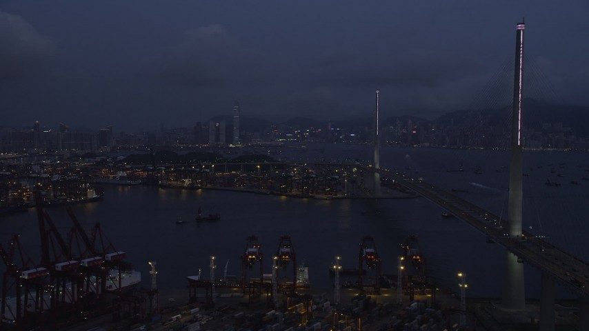 Flying by Stonecutters Bridge to Approach the Part of the Port of Hong Kong at Night Aerial Stock Footage SS01_0116