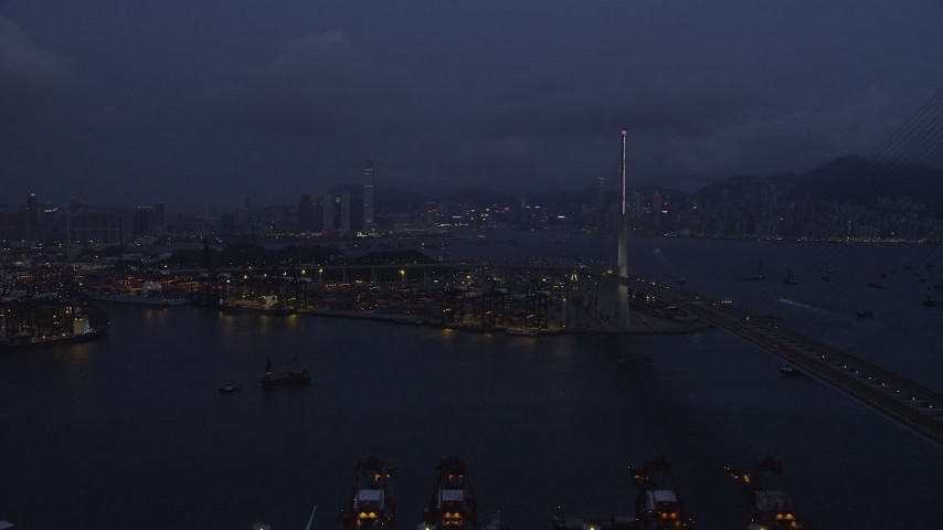 5K stock footage aerial video of flying by Stonecutters Bridge to approach part of the Port of Hong Kong at night in China Aerial Stock Footage | SS01_0116