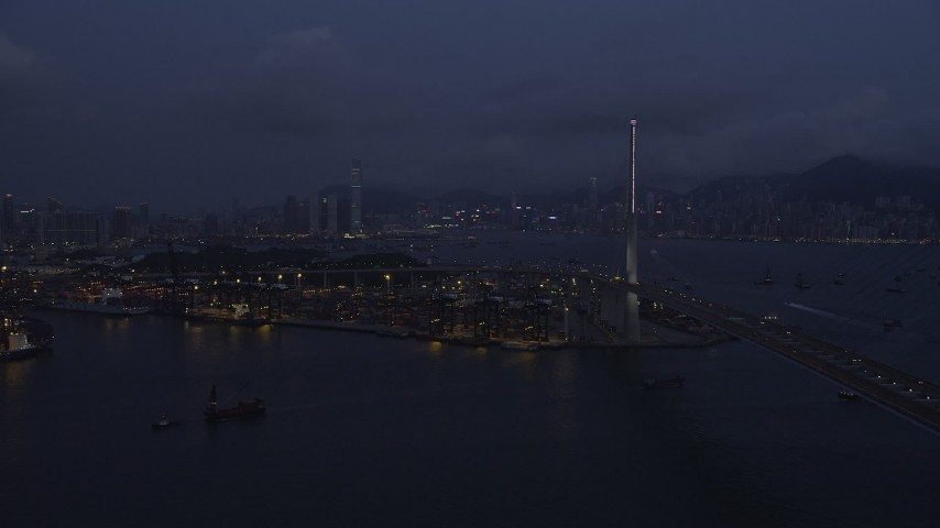 Approach Port of Hong Kong at End of the Stonecutters Bridge at Night Aerial Stock Footage | SS01_0117