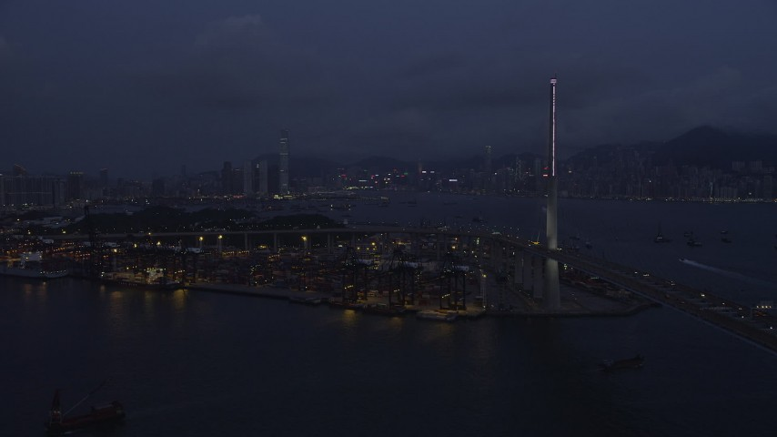 5K stock footage aerial video approach Port of Hong Kong at end of the Stonecutters Bridge at night in China Aerial Stock Footage | SS01_0117