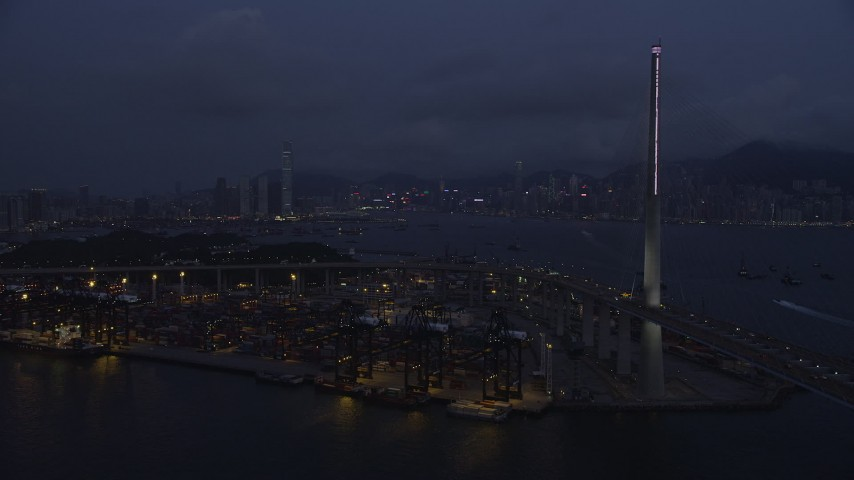 5K stock footage aerial video approach the shore of the Port of Hong Kong at night, China Aerial Stock Footage | SS01_0118