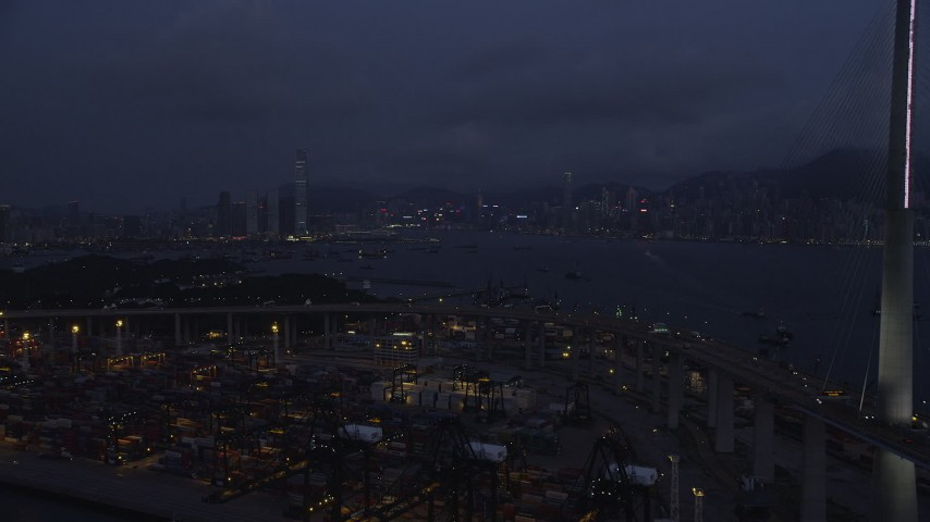 Fly Over Port of Hong Kong to Approach Kowloon and Hong Kong Island at Night Aerial Stock Footage | SS01_0119