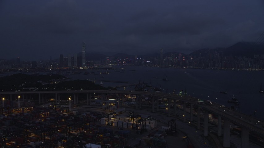 5K stock footage aerial video fly over Port of Hong Kong to approach Kowloon and Hong Kong Island at night, China Aerial Stock Footage | SS01_0119