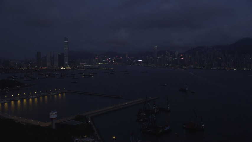 5K stock footage aerial video approach skylines of Kowloon Hong and Kong Island from the port at night, China Aerial Stock Footage | SS01_0121