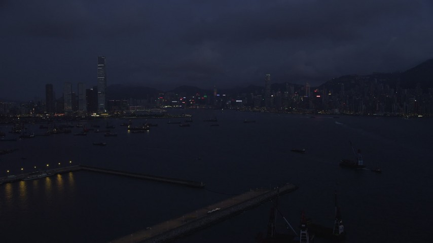 Approaching the Kowloon and Hong Kong Island Skylines at Night Aerial Stock Footage | SS01_0122