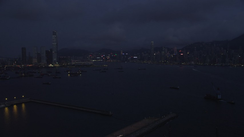 5K stock footage aerial video of approaching the Kowloon and Hong Kong Island skylines at night in China Aerial Stock Footage | SS01_0122