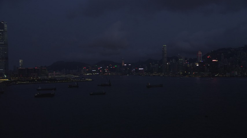 5K stock footage aerial video of Hong Kong Island skyline seen from cargo ships near the harbor at night, China Aerial Stock Footage | SS01_0125