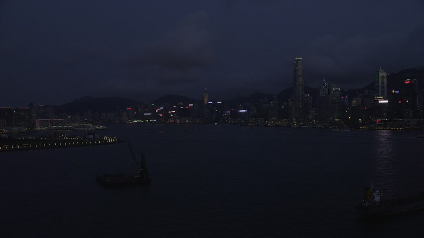 Approaching Hong Kong Island Skyline and the Harbor at Night Aerial Stock Footage | SS01_0127