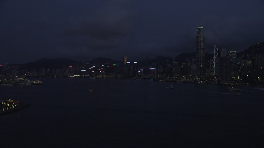 5K stock footage aerial video approach the Hong Kong Island skyline from Victoria Harbor at night, China Aerial Stock Footage | SS01_0128