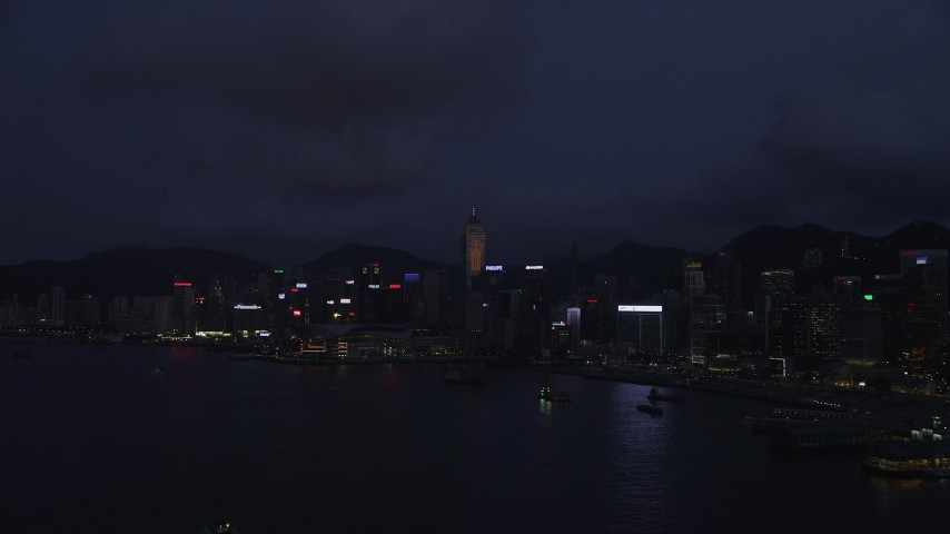 5K stock footage aerial video approach Hong Kong Island high-rises on the shore of the harbor at night, China Aerial Stock Footage | SS01_0131
